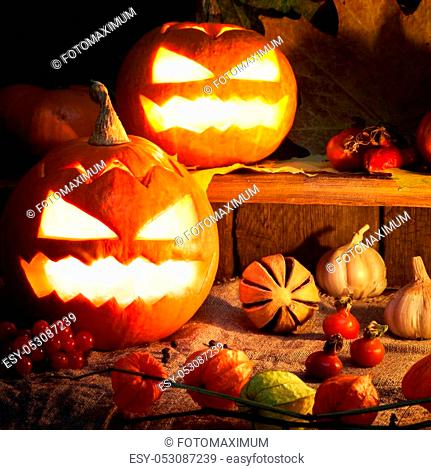 Happy Halloween wooden blocks with decor against an old wood background