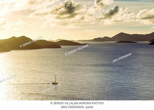 Scenic View Of Norman Island And Tortola Is Seen From Peter Island At Sunset