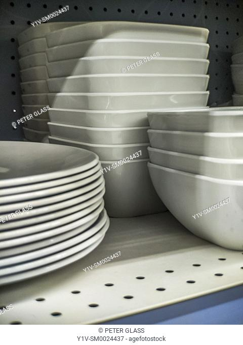 Stacks of white dishes and bowls