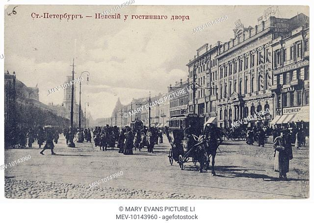 A busy street scene with horses and carts and pedestrians in Nevski Prospect, St Petersburg
