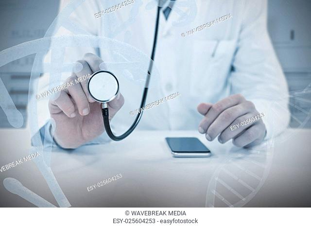 Composite image of midsection of doctor holding stethoscope