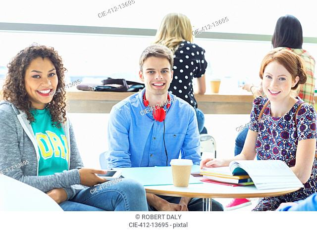 University students smiling in lounge