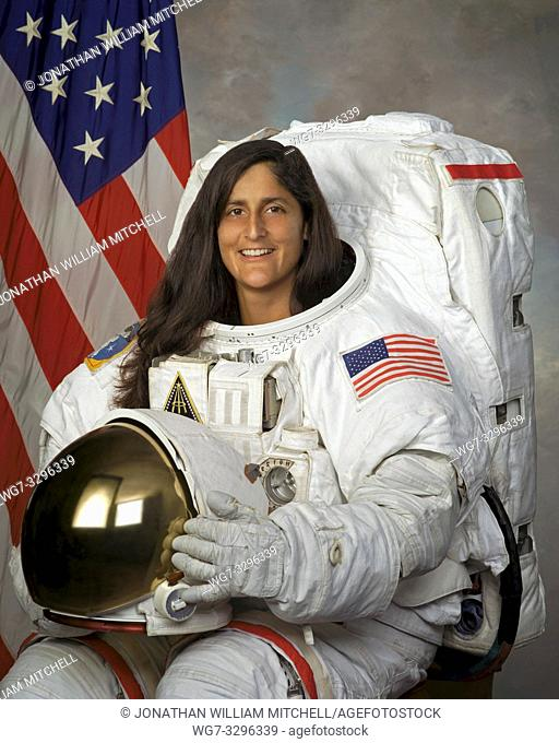 USA -- 22 Sep 2004 -- US NASA astronaut Sunita L Williams in a formal studio portrait sitting in spacesuit -- Picture by Lightroom Photos/NASA