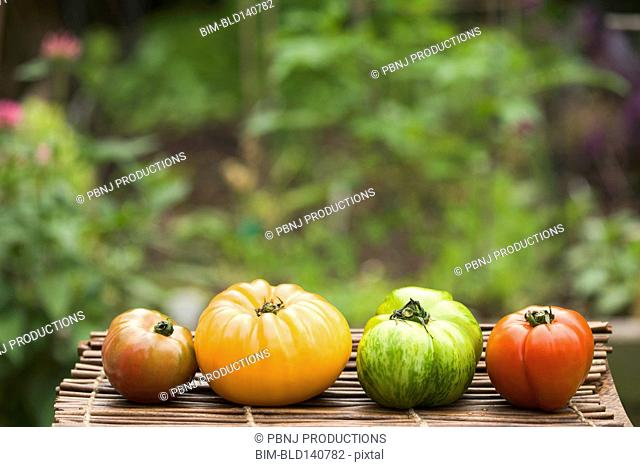 Colorful heirloom tomatoes on table outdoors
