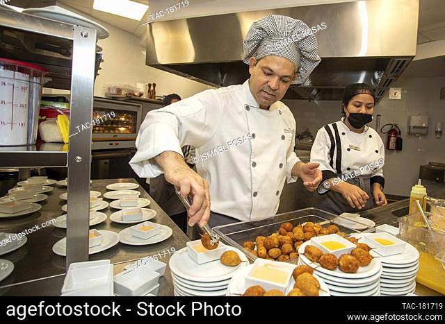 CANCUN, MEXICO - OCTOBER 10: Chef David Nunez prepares a dish food takes safety measures during the inauguration of the Brazilian restaurant 'Divina Carne' amid...