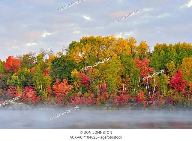Autumn reflections in misty St. Pothier Lake, Greater Sudbury, Ontario, Canada