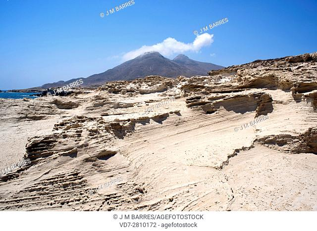 Fossil or fossilized dune. This photo was taken in Los Escullos, Cabo de Gata, Almeria, Andalusia, Spain. At the bottom you see two old volcanoes, Los Frailes