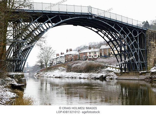 The famous Iron Bridge over the River Severn at the Ironbridge Gorge in Winter. It was the first arch bridge in the world to be made out of cast iron and was...