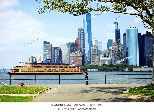 Staten Island Ferry in front of the Manhattan skyline viewed from Governorâ. . s island. New York city. USA