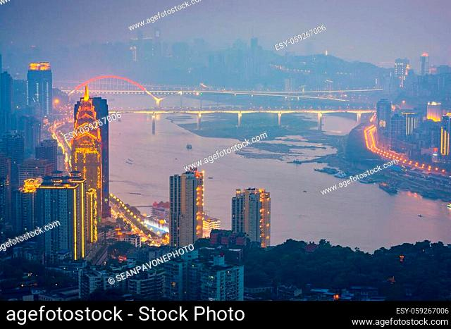 Chongqing, China downtown city skyline over the Yangtze River at sunset
