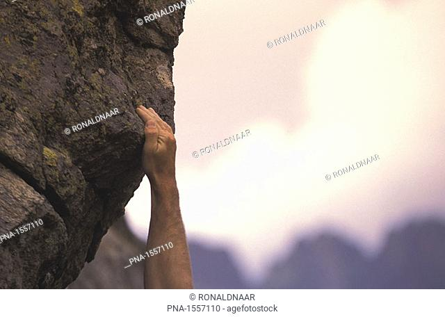 Reaching for the next hold, sports climbing