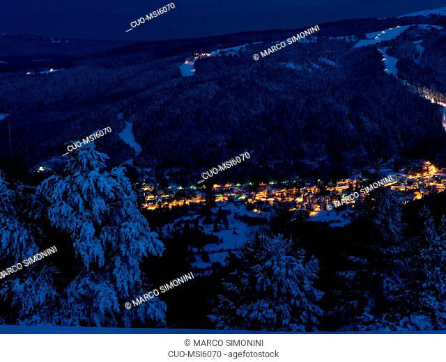 Winter landscape from Finonchio with view on Folgaria village, Altipiano di Folgaria plateau, Trentino, Italy, Europe