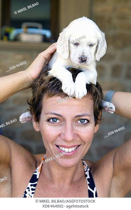 young girl with a dog puppy of the English Setter breed