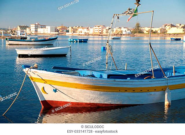 Fishing boats in the small harbour of the sea village Marzamemi, Southeast Sicily, in the early morning