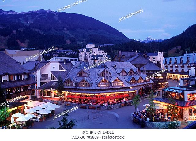 Whister village at dusk with mountain beyond, Whistler, British Columbia, Canada
