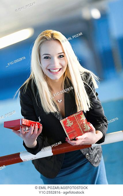 Beautiful teenager girl surprised by present box