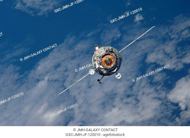 Backdropped by a blue and white part of Earth, the new unpiloted Russian Mini-Research Module 2 (MRM2), also known as Poisk