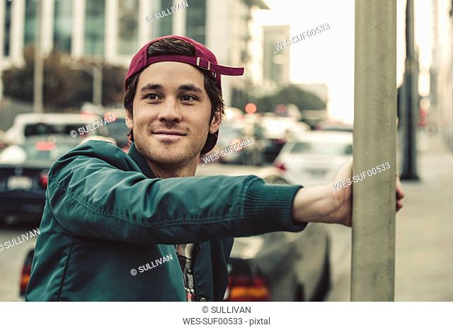 Portrait of smiling young man in the city
