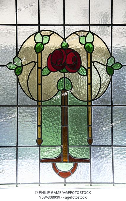 Leadlight glass motifs in a 1913 Art Nouveau Queenslander house, Brisbane, Australia