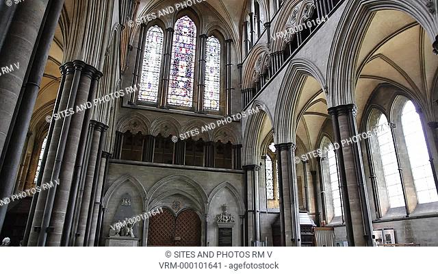 PAN and TILT up, interior, looking east. Shot of the west doors closed, the west window, arcade and aisle, Triforium\Gallery windows