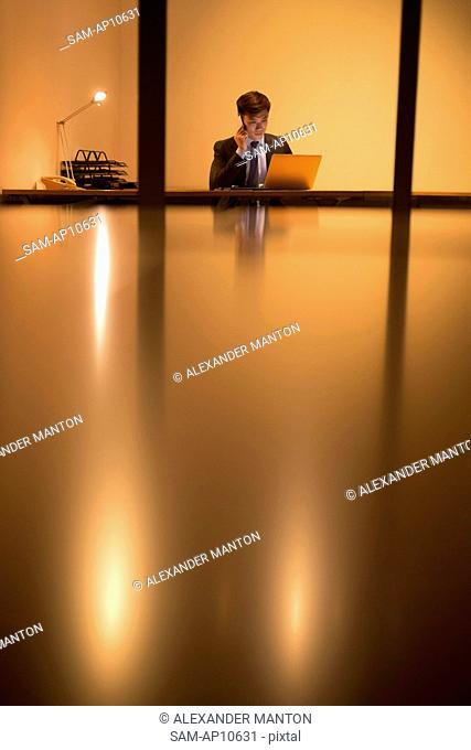 Singapore, Businessman working in office at night
