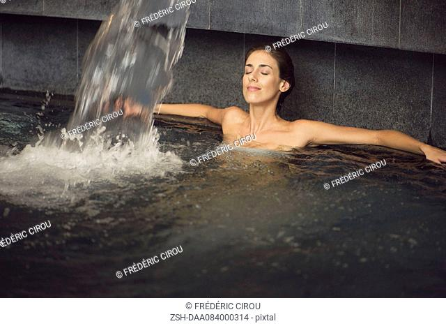 Woman soaking in spa pool