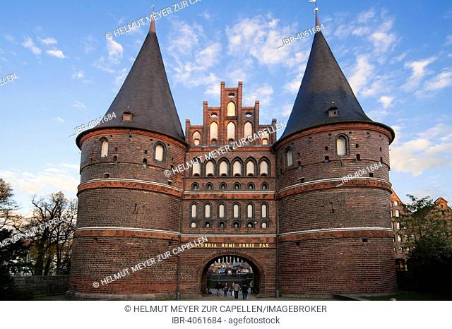 Holsten Gate in the evening light, built from 1464-1678, landmark and former section of the fortification, Lübeck, Schleswig-Holstein, Germany