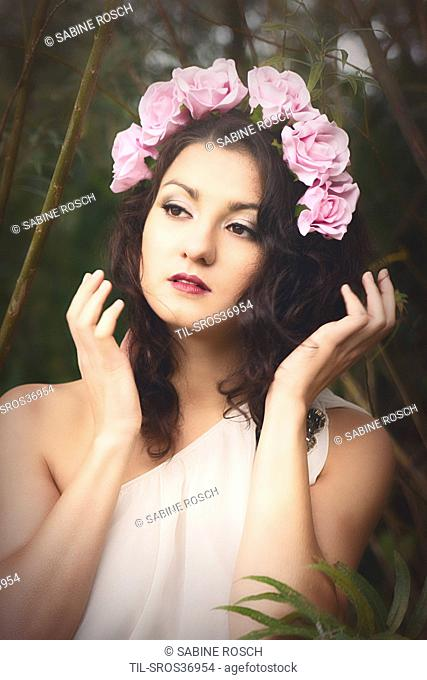 female with brown hair wearing roses in her hair