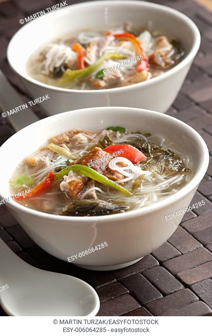 Roast duck and rice noodle soup in a bowl