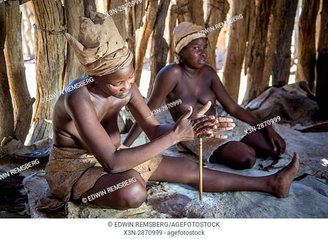 Damaran women making a buttons out of bone at the Damara Living Museum in Twyfelfontein, located in the southern region of Namibia, Africa