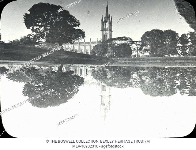 Black and white lantern slide of looking across calm water to church and reflection. Slide number 20 of Box 221 Boswell Collection