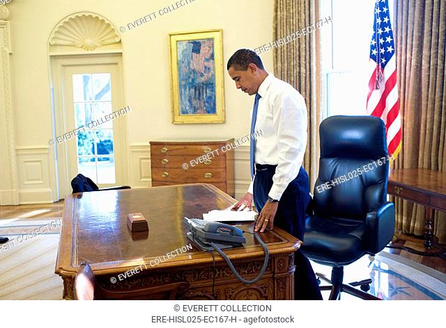 President Barack Obama on his first morning in the Oval Office as President of the United States. Jan. 21 2009., Photo by: Everett Collection(BSLOC-2011-7-215)