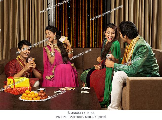 Friends playing cards on Diwali