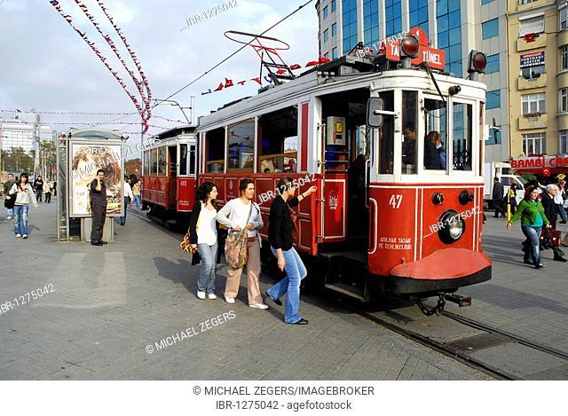Tram at Taksim Square, Taksim Cumhuriyet Abidesi, Istanbul, Turkey