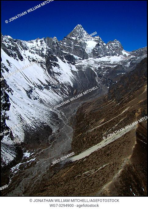 NEPAL Ngozumpa Glacier -- 16 Apr 2005 -- Aerial view of main glaciers off the main Ngozumpa (Gokyo) glacier (right), crowned by Chadoten Peak (5065m)