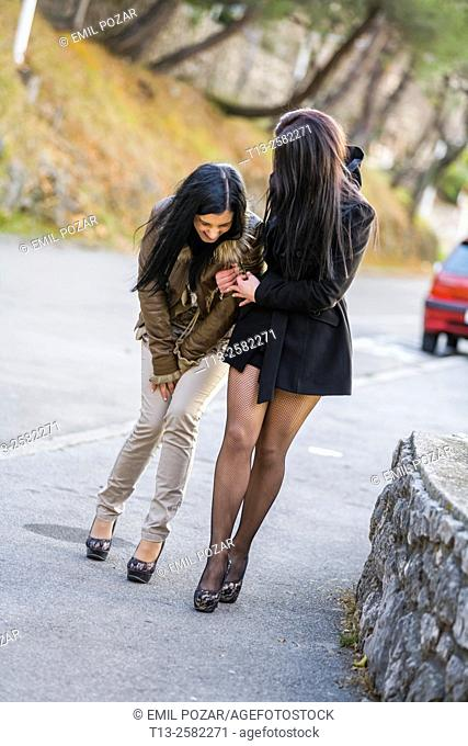 Young women and helping hand after night out