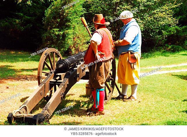 Two adult men demonstrate firing a Colonial era canon in Jamestown Virginia