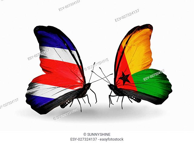Two butterflies with flags on wings as symbol of relations Costa Rica and Guinea Bissau
