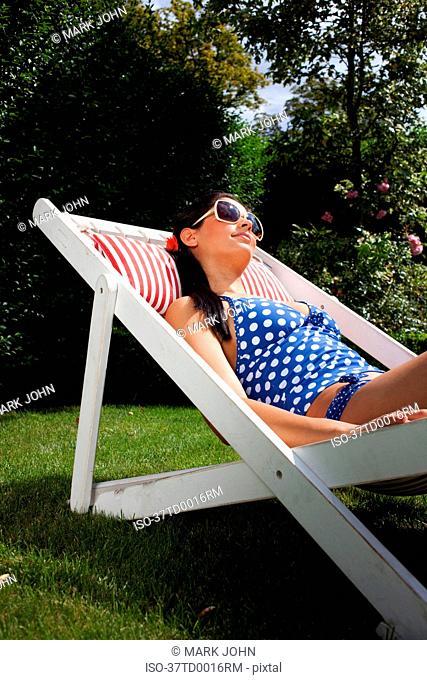 Woman sunbathing in swimsuit