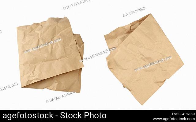 folded blank brown kraft paper sheet isolated on white background, template for designer, set