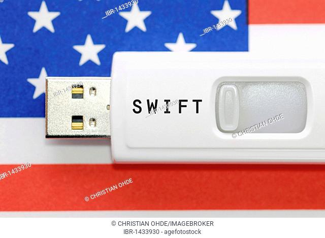 Memory stick with inscription Swift in front of the U.S. flag, Swift Agreement