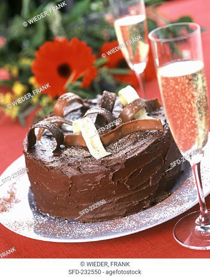 Festive chocolate gateau, champagne and bouquet (1)