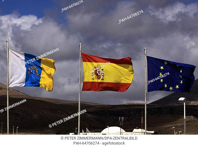 Spains national flag on the Arrecife Airport on the Canary Island Lanzarote, Spain, 10 October 2015. Next to it is the flag of the Canary Islands (L) and the...