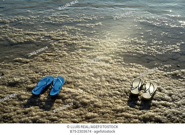 Closeup of flip-flops on the salty shore of the Dead Sea, Israel, Middle East