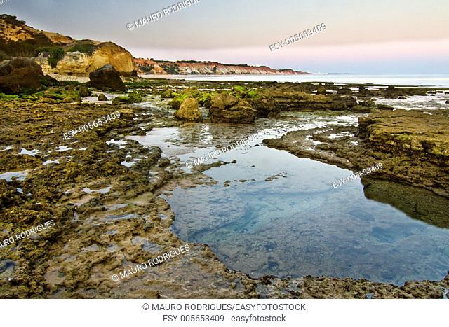 View of the beautiful coastline near Olhos D'Agua in the Algarve, Portugal