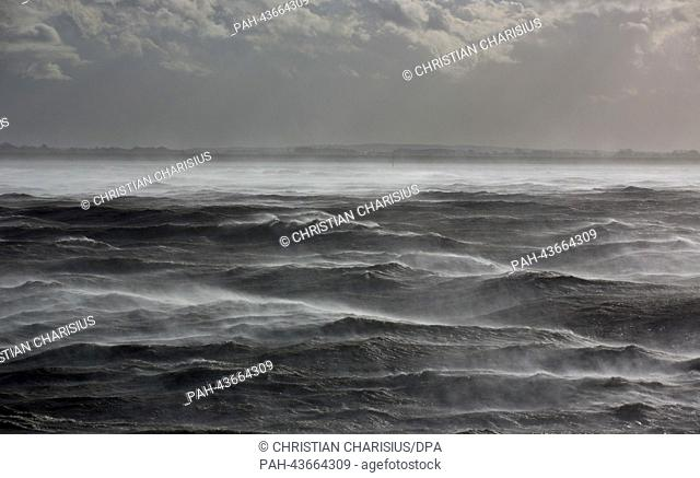 Foam moves across the waves of the Elbe in front of the estuary mouth into the North Sea near Brunsbuettel, Germany, 28 October 2013