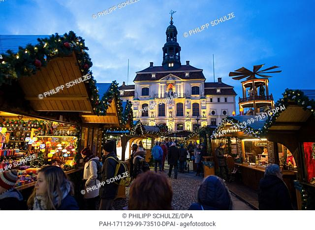 People across the Christmas market at the city hall in Lueneburg, Germany, 29 November 2017. The Christmas market is open until 22 December