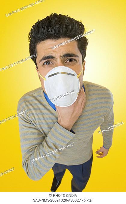 Businessman wearing pollution mask