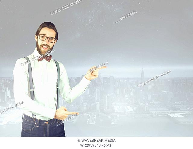 Stylish Man pointing at a city