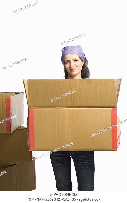 Portrait of a woman carrying a cardboard box